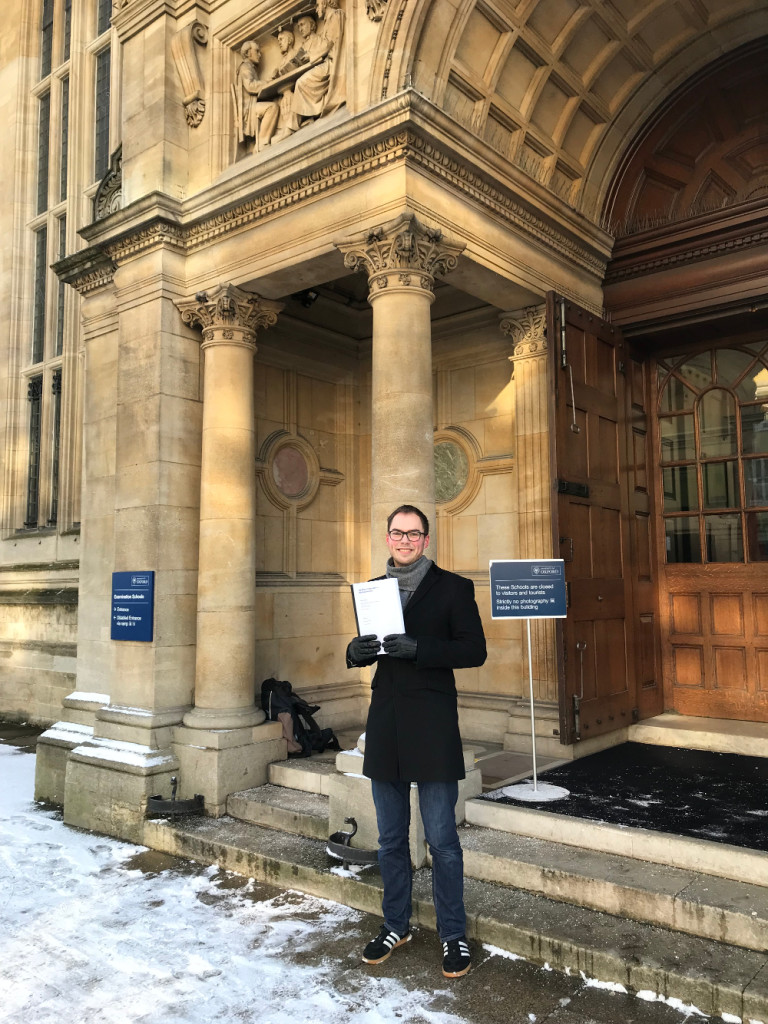 Photo of Edwin Dalmaijer handing in their DPhil thesis.